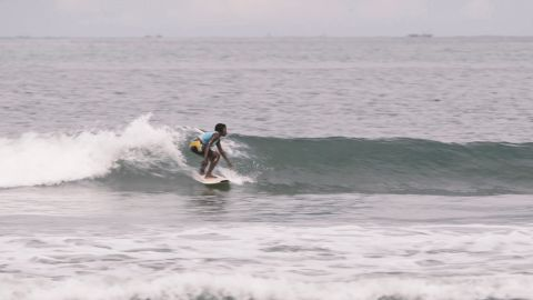 Bureh Beach Surf Club was started by NGO worker Shane O'Connor and is run today by locals. Nineteen members share communal surfboards and teach children as young as five to surf.