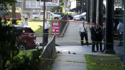 Sandals remain on a New York sidewalk following the shooting.