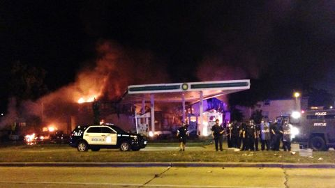 A gas station burns as dozens protest in Milwaukee on Aug. 13.