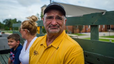 Youngsville police Chief Rickey Boudreaux takes a break from helping flood victims to view the damage to his own home on August 14.
