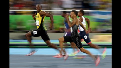 """Jamaican sprinter Usain Bolt looks back at his competitors during a 100-meter semifinal on Sunday, August 14. Bolt <a href=""""http://www.cnn.com/2016/08/14/sport/usain-bolt-justin-gatlin-olympic-games-100-meters-rio/"""" target=""""_blank"""">won the final</a> a short time later, becoming the first man in history to win the 100 meters at three straight Olympic Games."""