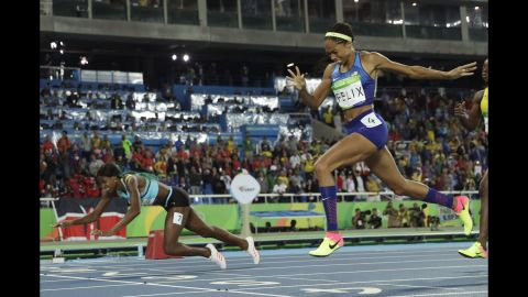 """Shaunae Miller of the Bahamas <a href=""""http://edition.cnn.com/2016/08/15/sport/allyson-felix-athletics-olympics/index.html"""" target=""""_blank"""">dives over the finish line</a> to win gold in the 400 meters on Monday, August 15. She edged out American Allyson Felix by .07 seconds."""