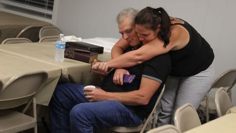 Robert Enfinger and his wife, Michelle, spend the night in a church that had been turned into an evacuation shelter in Walker.