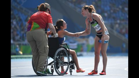 """Abbey D'Agostino of the United States leaves the track on a wheelchair after twisting her ankle in the 5000-meter semifinal on Tuesday, August 16. D'Agostino and New Zealand's Nikki Hamblin, right, <a href=""""http://www.nbcolympics.com/video/us-runner-finishes-race-after-falling-hard"""" target=""""_blank"""" target=""""_blank"""">collided during the race</a> but helped each other up and managed to make it to the finish line."""