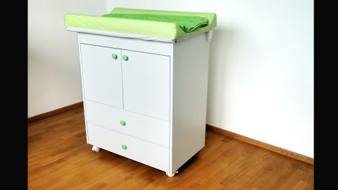 """Changing tables, like all large furniture items, should be <a href=""""https://www.healthychildren.org/English/safety-prevention/at-home/Pages/Preventing-Furniture-and-TV-Tip-Overs.aspx"""" target=""""_blank"""" target=""""_blank"""">anchored to walls to prevent tipping</a>. The American Academy of Pediatrics urges parents to <a href=""""https://www.healthychildren.org/English/safety-prevention/at-home/Pages/Changing-Table-Safety.aspx"""" target=""""_blank"""" target=""""_blank"""">never step away from a baby on a changing table</a>, even if the child is buckled or seems too young to roll."""