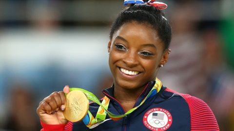 Gold medalist Simone Biles of the United States celebrates on the podium at the medal ceremony for the Women's Floor on Day 11 of the Rio 2016 Olympic Games, August 16, 2016 in Rio de Janeiro, Brazil.