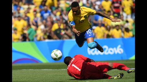 """Brazilian soccer star Neymar goes for goal during a semifinal match against Honduras. He scored within the first 15 seconds, and <a href=""""http://www.cnn.com/2016/08/17/sport/brazil-beats-honduras-to-set-up-rematch-with-germany-in-olympic-final/index.html"""" target=""""_blank"""">Brazil won 6-0.</a>"""