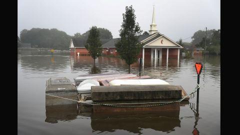 Caskets float in floodwaters near a cemetery in Gonzales on August 17.
