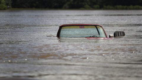 A pickup truck is partially submerged in Port Vincent, Louisiana, on August 16.