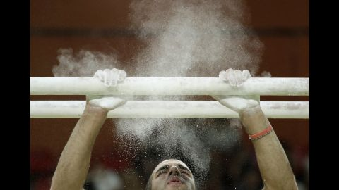 U.S. gymnast Danell Leyva prepares for his performance on the parallel bars during the exhibition gala. Leyva won silver on the apparatus on Tuesday.