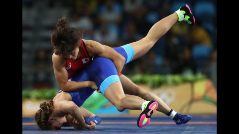 """Japanese wrestler Kaori Icho, in red, defeated Russia's Valeria Koblova for the gold medal in the 58-kilogram (128-pound) weight class. It was the <a href=""""http://www.cnn.com/2016/08/17/sport/kaori-icho-wrestling-rio/index.html"""" target=""""_blank"""">fourth straight Olympic gold medal</a> for Icho, who became the first female in any sport to win an individual-event gold at four Olympics."""