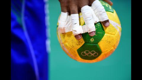 An athlete grips a handball during the quarterfinal round.