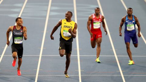 """Canada's Andre De Grasse, left, and Jamaica's Usain Bolt smile at each other during a 200-meter semifinal on Wednesday, August 17. Bolt <a href=""""http://www.cnn.com/2016/08/17/sport/usain-bolt-justin-gatlin-200m-rio/index.html"""" target=""""_blank"""">finished first,</a> just in front of De Grasse."""