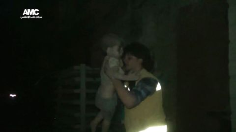 """A civil defense worker carries Omran into the ambulance. The airstrike destroyed Omran's home, where he lived with his parents and two siblings. Director of the Aleppo Media Center Yousef Saddiq said Omran's 10-year-old brother, Ali, <a href=""""http://www.cnn.com/2016/08/20/middleeast/syria-conflict/index.html"""" target=""""_blank"""">died from his injuries</a> on Saturday, August 20."""