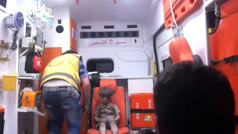 """The bloodied boy sits and waits for medical attention. An Aleppo Media Center activist <a href=""""http://www.cnn.com/2016/08/17/world/syria-little-boy-airstrike-victim/index.html"""" target=""""_blank"""">told CNN</a> that Omran did not cry at any point during the rescue and appeared to be in extreme shock."""