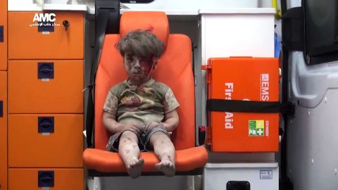 """This still image, taken from a <a href=""""https://www.youtube.com/watch?v=7cfBmRW3isc"""" target=""""_blank"""" target=""""_blank"""">video posted by the Aleppo Media Center,</a> shows a young boy in an ambulance after an airstrike in the northern Syrian city of Aleppo on Wednesday, August 17. The boy has been identified as Omran Daqneesh, and the video of him has been circulating on social media."""