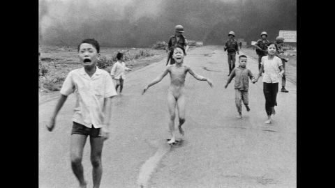 """<strong>1972: Trang Bang, South Vietnam </strong>-- Nine-year-old Kim Phuc wails in agony as she and her fellow villagers flee a napalm attack. This unflinching look into the horrors of the Vietnam War earned a Pulitzer Prize. Phuc survived, and <a href=""""http://www.cnn.com/2015/06/22/world/kim-phuc-where-is-she-now/"""" target=""""_blank"""">eventually started her own foundation</a> to aid child victims of war."""