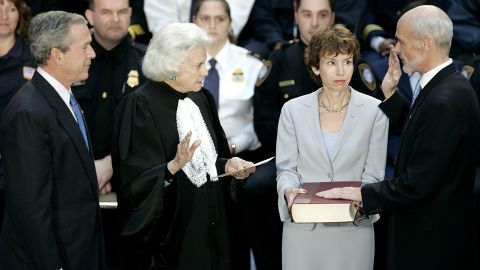 President George W. Bush, left, watches as Homeland Security Secretary Michael Chertoff, right, is sworn in by O'Connor in March 2005. Chertoff's wife, Meryl, is holding the Bible.