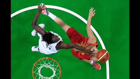 """U.S. basketball player Tina Charles, left, and Spain's Laura Gil battle for the ball in the final game on Saturday, August 20. The Americans earned yet another gold, making it their <a href=""""http://www.cnn.com/2016/08/20/sport/rio-olympics-womens-basketball-usa-spain-final/"""" target=""""_blank"""">sixth straight Olympic win</a>."""
