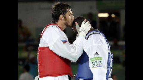 Radik Isaev of Azerbaijan, left, kisses Great Britain's Mahama Cho after defeating Cho in the over 80-kilogram (176-pound) semifinal taekwondo event.