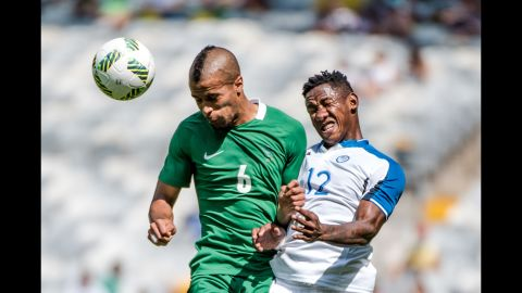Nigeria's William Ekong, left, and Romell Quioto of Honduras jump for a header during their bronze medal soccer match. The Nigerian team won its country's first Olympic medal since the Beijing 2008 Games and its third soccer medal in its history.