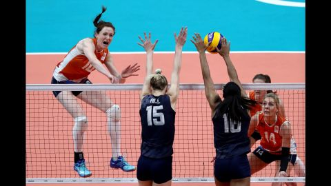 Volleyball players from the Netherlands, in orange, and the United States compete in the bronze medal match. The Americans won.