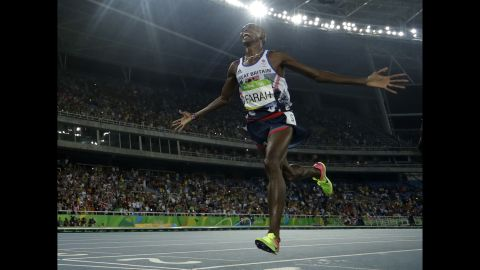 Britain's Mo Farah crosses the line to win the gold medal in the men's 5,000-meter final.