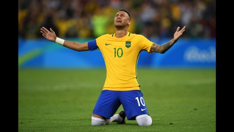 Neymar of Brazil becomes emotional after scoring the winning penalty in a shoot against Germany during the men's football final.