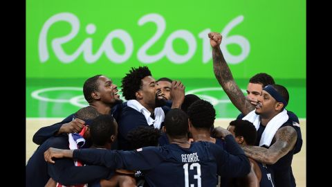 The U.S. basketball team celebrates after defeating Serbia in the gold medal game on Sunday, August 21. The Americans' victory marks their third straight Olympic gold.