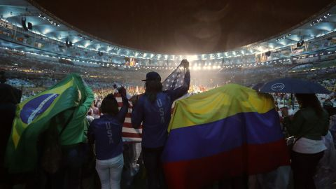 People wave flags from Brazil, the United States and Colombia during the Olympics closing ceremony at Maracana stadium in Rio de Janeiro, Brazil, on Sunday, August 21.