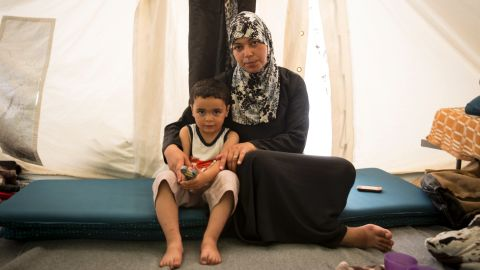 """""""I didn't want to leave Syria, but our house was destroyed,"""" says Salwa, a 38-year-old teacher from Damascus, Syria, living in Softex Camp in Greece with her three-year-old son Hadi."""