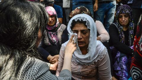 Mourners at a funeral for victims of the bombing of the wedding party in Gaziantep.