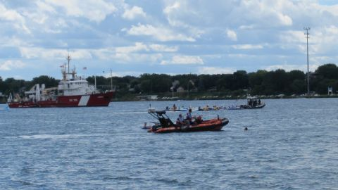 A Canadian Coast Guard rescue vessel assists floaters in need on the St. Clair River.
