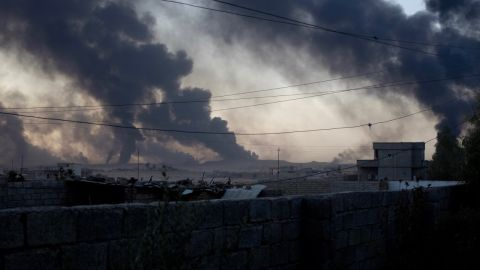 Smoke rises from Qayyarah in an afternoon as ISIS burns crude oil to block visibility from above.