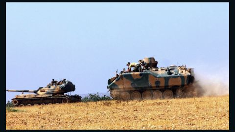 Turkish military vehicles move near the Syrian border in Karkamis on Tuesday.