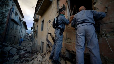 Rescuers search for victims in Amatrice on August 24.