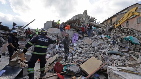 Rescuers search for survivors in the rubble in Amatrice.