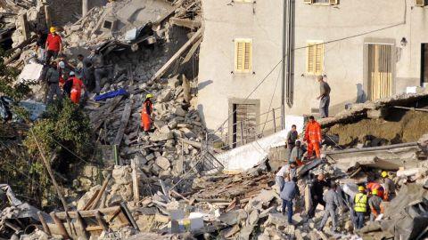 Search-and-rescue teams look for survivors in Pescara del Tronto.