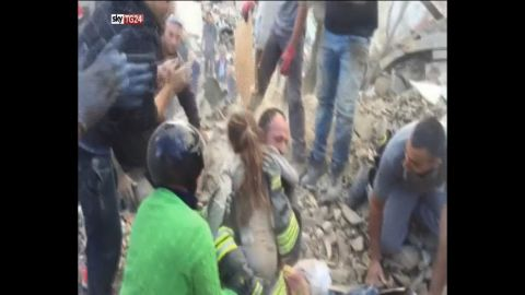 An 8-year-old girl is rescued from under a collapsed building