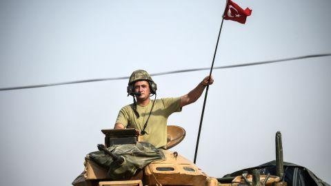 Turkish tanks near Karkamıs head toward the Syrian town of Jarabulus in August.