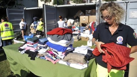Emergency team members set up a tent camp for earthquake victims at a sports field in Arquata del Tronto on August 26.