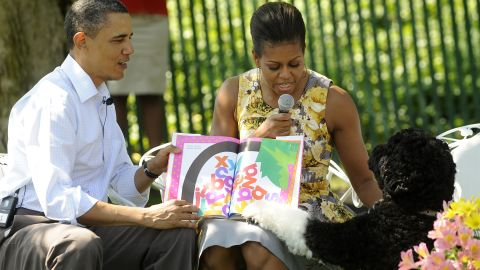 Obama and the first lady read to children with Bo during the White House Easter Egg Roll on the South Lawn of the White House on April 25, 2011.