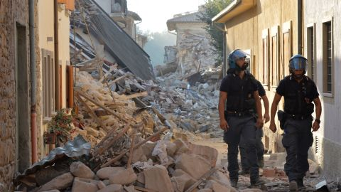 Police inspect rubble and debris in Amatrice, Italy, on August 27.