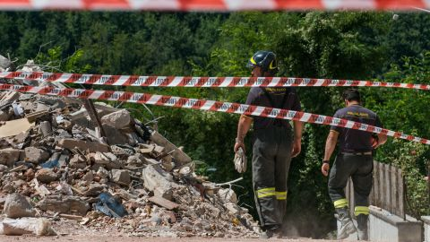 Emergency personnel survey a cordoned-off area in the center of Amatrice. Much of the town is now inaccessible to everyone but authorities.