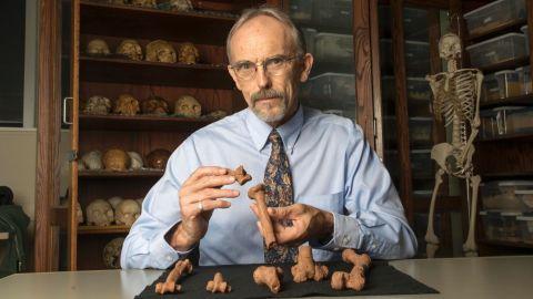 John Kappelman with 3D printouts of Lucy's skeleton.