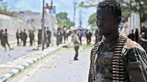 A Somali security force member surveys the blast site Tuesday.