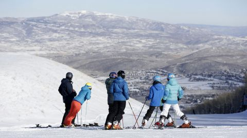 Winter or summer, Park City is the center of a booming tourism industry. In the warmer months, there's biking and hiking. When snow falls, skiers like this group head to Park City Mountain Resort.