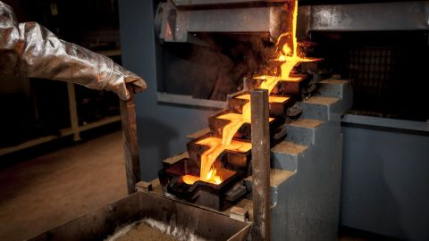 """Picture taken on January 24, 2014 at Agbaou gold mine, located approximately 200km northwest of the port city of Abidjan shows the ongoing production of the mine's first ingot. Canada's Endeavour Mining opened the Agbaou gold mine on January 2014 for a total cost of 180 millions of dollars, with annual production expected to reach three tonnes. With this fourth gold mine, Ivory coast's Governement expect to reach the """"national gold production from 13 to 16 tons per year."""" AFP PHOTO/STR        (Photo credit should read STR/AFP/Getty Images)"""