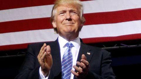 Donald Trump applauds the crowd during a campaign rally on August 31, 2016 in Phoenix, Arizona.