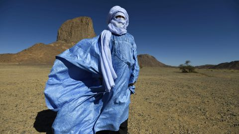 """Tuaregs are the only tribal communities in which <a href=""""http://travel.cnn.com/surviving-sahara-468896/"""">men wear veils instead of women</a>. The tangelmust, a wrapped headdress up to eight meters in length, is ubiquitous among the """"blue men of the desert."""" The name does not allude to the muslin headdress, dyed with indigo, but rather because the dye gradually leeches out into the skin of the wearer. Tuaregs use the tangelmust for practical reasons: it protects from the sun and sand, but men will still wear them at night, and even during meals. Men cover their faces with the tangelmust in front of strangers and women, while women are free to show their face."""